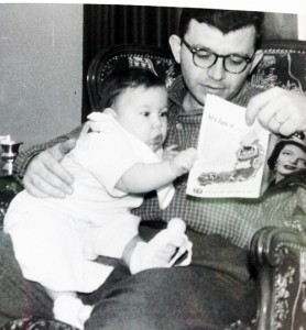 Dad holding me on his lap and reading